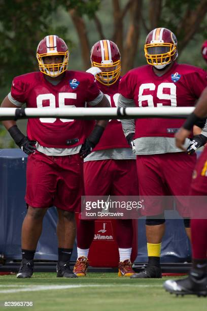 Washington Redskins defensive lineman Jonathan Allen and AJ Francis watch their teammates during the Redskins training camp afternoon practice on...