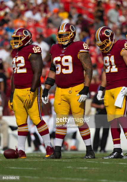 Washington Redskins defensive lineman Stacy McGee 92 AJ Francis and linebacker Ryan Kerrigan look on while waiting for the Bengals to break huddle...