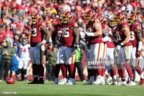 Washington Redskins defensive linemen Jonathan Allen Daron Payne Matt Ioannidis and linebacker Ryan Kerrigan during the game between the Atlanta...