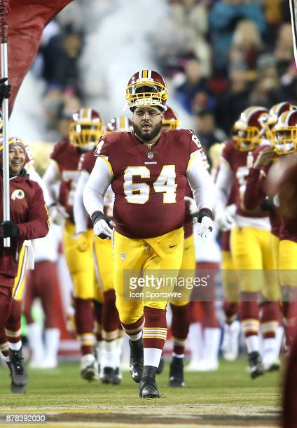 Washington Redskins defensive linesman AJ Francis leads the team onto the field before a NFL game between the Washington Redskins and the New York...