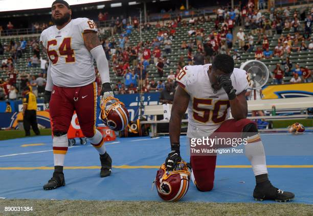 CARSON CA DECEMBER Washington Redskins defensive tackle AJ Francis and Washington Redskins inside linebacker Martrell Spaight after losing the game...