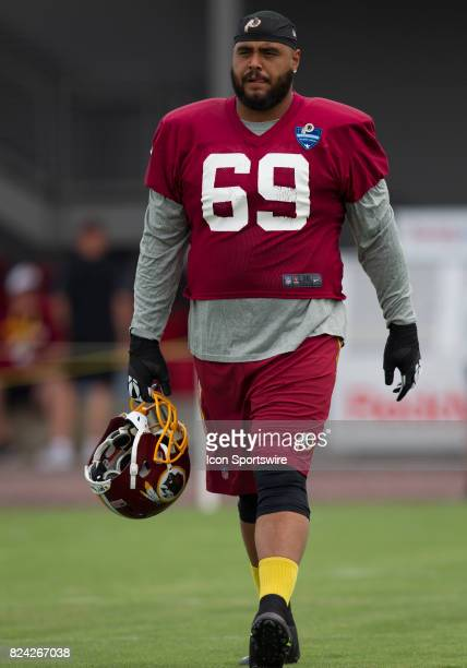 Washington Redskins defensive tackle AJ Francis walks onto the field prior to practice during day one of Redskins training camp at Bon Secours...