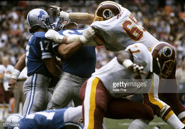Washington Redskins defensive tackle Dave Butz puts a heavy pass rush on Lions quarterback Eric Hipple during the Redskins 243 victory over the...