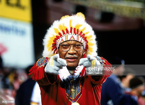 Washington Redskins fan 'Chief Zee' watches the game against the Philadelphia Eagles on December 27 2003 at FedEx Field in Washington DC