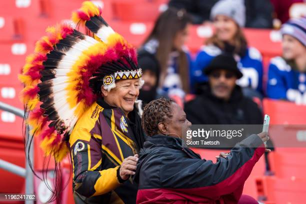 Washington Redskins Fan with traditional Native American headdress stands for a photo before the game between the Washington Redskins and the New...