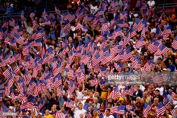 Washington Redskins fans wave their American Flags before the game against the Minnesota Vikings on September 11 2006 at FedExField in Landover...