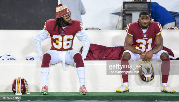 Washington Redskins free safety DJ Swearinger and cornerback Fabian Moreau sit on the bench following their loss to the Tennessee Titans at Nissan...