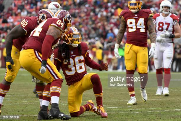 Washington Redskins free safety DJ Swearinger is congratulated by defensive tackle AJ Francis and defensive end Stacy McGee after a sack against the...