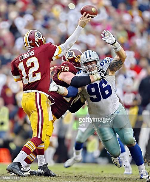 Washington Redskins guard Kory Lichtensteiger blocks Dallas Cowboys defensive tackle Nick Hayden as he tries to pressure quarterback Kirk Cousins...