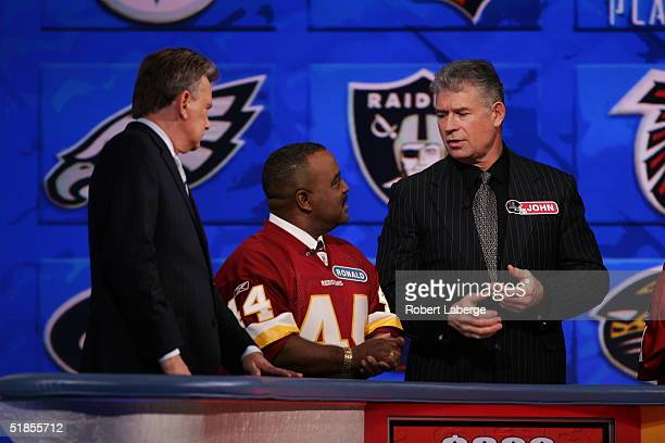 Washington Redskins Hall of Fame running back John Riggins talks with his favorite Redskins fan as Host Pat Sajak listens during the Wheel of Fortune...