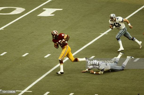 Washington Redskins Hall of Fame wide receiver Charley Taylor heads for the endzone in a 2423 Thanksgiving Day loss to the Dallas Cowboys in 1974 in...