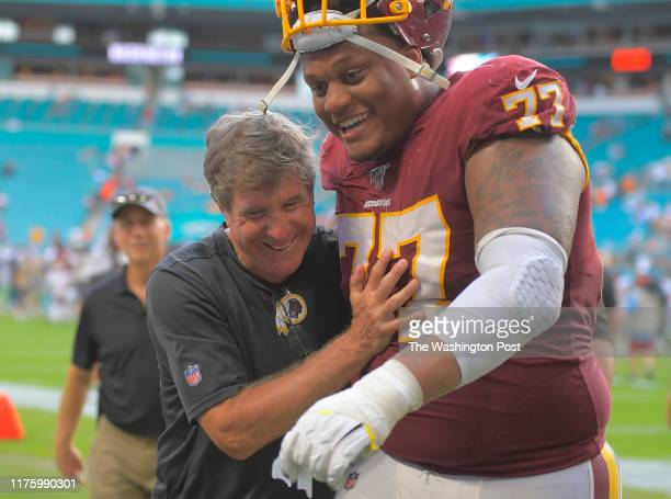Washington Redskins head coach Bill Callahan, left, is congratulated by Washington Redskins offensive tackle Ereck Flowers after Callahan won his...