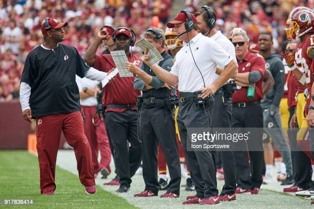 Washington Redskins head coach Jay Gruden talks into his headset during a NFL football game between the San Francisco 49ers and the Washington...