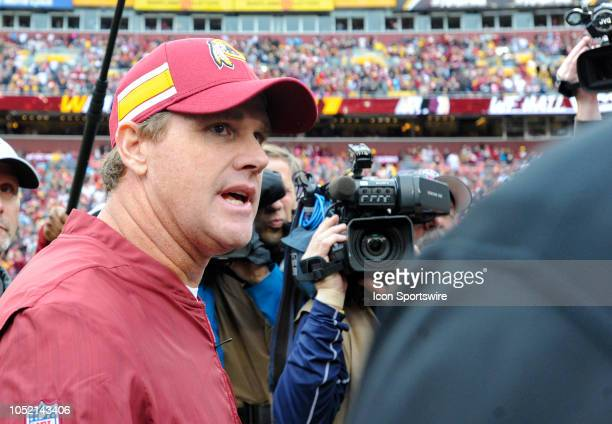 Washington Redskins head coach Jay Gruden walks off the field following the game against the Carolina Panthers on October 14 at FedEx Field in...