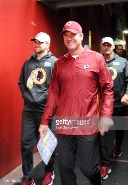 Washington Redskins head coach Jay Gruden walks on to the field for the game against the Carolina Panthers on October 14 at FedEx Field in Landover...