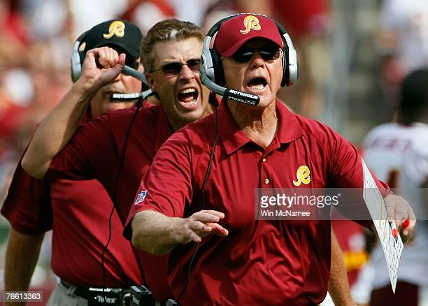 Washington Redskins head coach Joe Gibbs and assistant head coach defense Gregg Williams call for a timeout on the game winning drive in overtime...