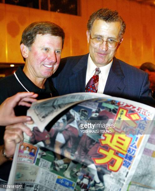 Washington Redskins head coach Steve Spurrier and National Football League Commissioner Paul Tagliabue read a sports paper which carries a picture of...