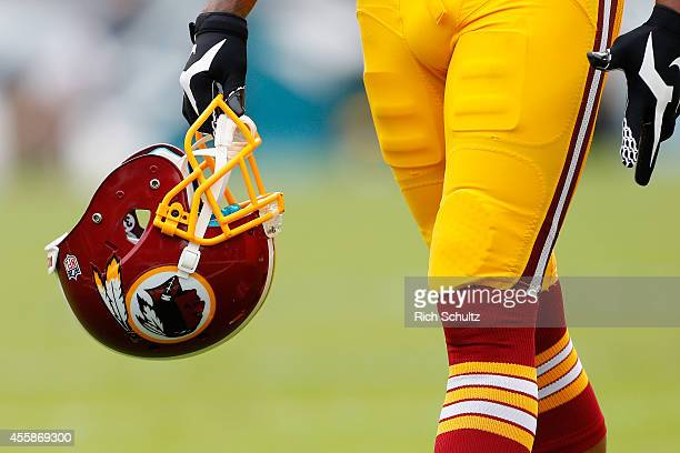Washington Redskins helmet is carried by a player before the game against the Philadelphia Eagles at Lincoln Financial Field on September 21 2014 in...
