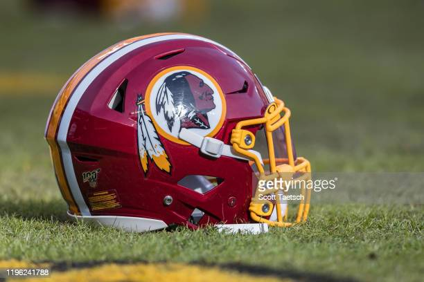 Washington Redskins helmet is seen on the field before the game between the Washington Redskins and the New York Giants at FedExField on December 22...
