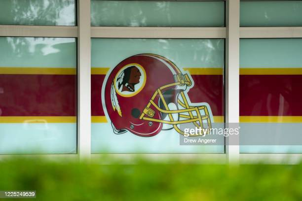 Washington Redskins helmet logo adorns a window on the outside of FedEx Field on July 7, 2020 in Landover, Maryland. After receiving recent pressure...