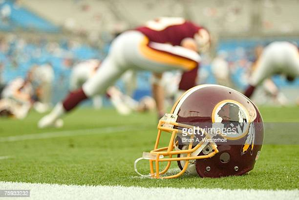 Washington Redskins helmet rests on te field as the team goes through their pre-game stretching prior to playing the Carolina Panthers at Bank of...