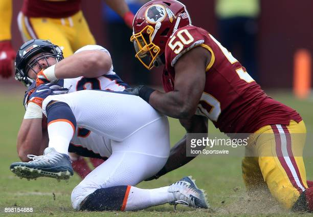 Washington Redskins inside linebacker Martrell Spaight tackles Denver Broncos fullback Andy Janovich during a NFL game between the Washington...