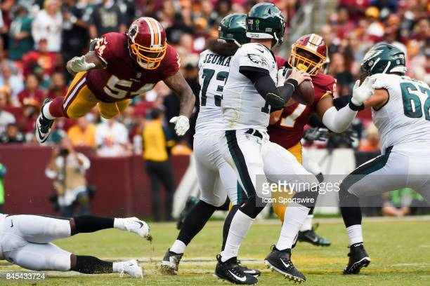 Washington Redskins inside linebacker Mason Foster leaps in the air to try and tackle Philadelphia Eagles quarterback Carson Wentz on September 10 at...