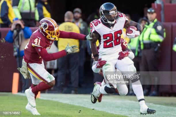 Washington Redskins inside linebacker Zach Brown and defensive back Danny Johnson tackle Atlanta Falcons running back Tevin Coleman during a NFL game...