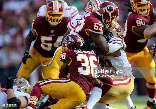 Washington Redskins inside linebacker Zach Brown and Washington Redskins free safety DJ Swearinger take down San Francisco 49ers running back Carlos...