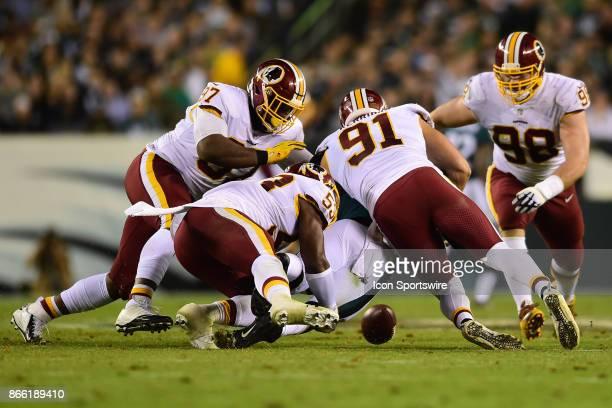 Washington Redskins inside linebacker Zach Brown and Washington Redskins outside linebacker Ryan Kerrigan sack Philadelphia Eagles quarterback Carson...