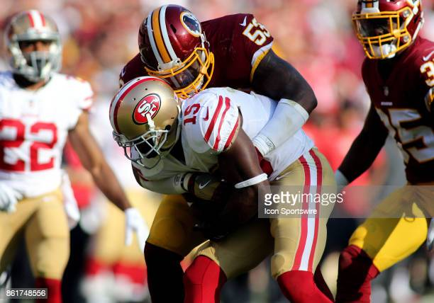 Washington Redskins inside linebacker Zach Brown lays a hard hit on San Francisco 49ers wide receiver Pierre Garcon during a match between the...