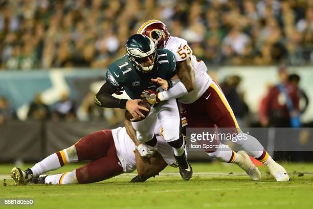 Washington Redskins inside linebacker Zach Brown sacks Philadelphia Eagles quarterback Carson Wentz during a NFL football game between the Washington...