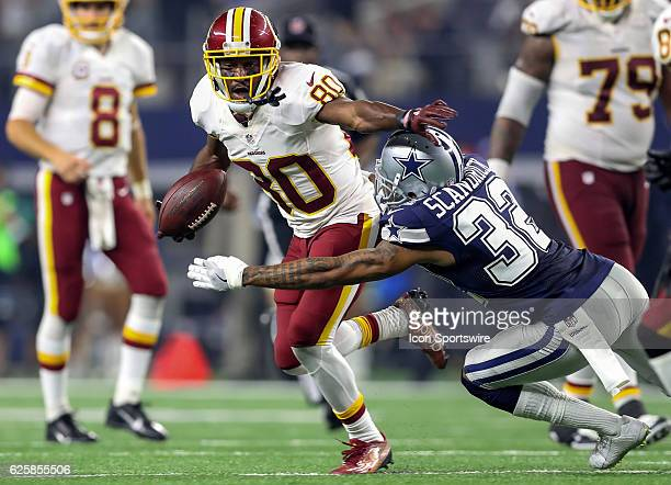 Washington Redskins Jamison Crowder tries to elude Cowboys Orlando Scandrick during the NFL game between the Dallas Cowboys and the Washington...