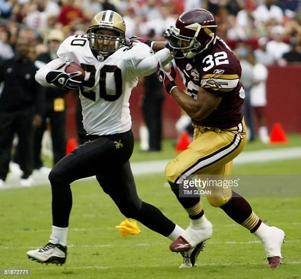 Washington Redskins Kenny Watson tries to pull down Jay Bellamy of the New Orleans Saints who had just picked off a Ramsey pass during the first half...
