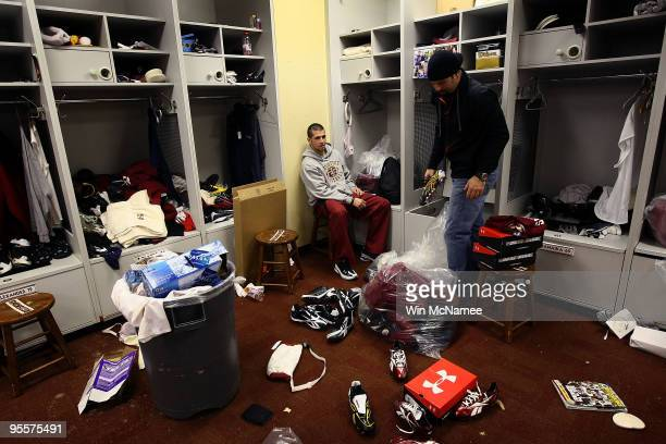 Washington Redskins kicker Graham Gano and punter Hunter Smith clean out their lockers before a press conference by Redskins General Manager Bruce...