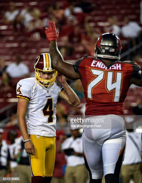 Washington Redskins kicker Zach Hocker unsnaps his helmet after missing a 39yard field goal in the fourth quarter during the preseason game between...
