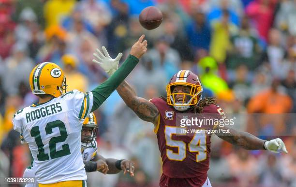 Washington Redskins linebacker Mason Foster gets a hand in the face of Green Bay Packers quarterback Aaron Rodgers during a game between the...
