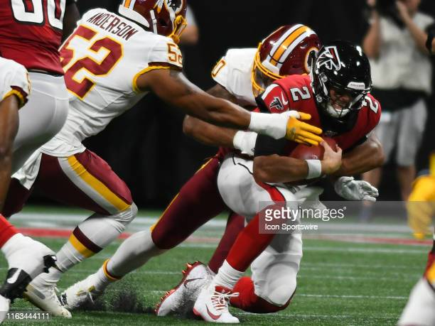 Washington Redskins Linebacker Montez Sweat sacks Atlanta Falcons Quarterback Matt Ryan during the NFL preseason game between the Washington Redskins...