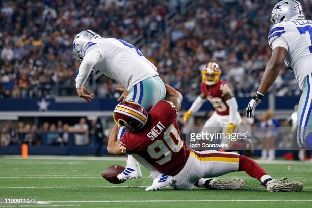 Washington Redskins Linebacker Montez Sweat strips the ball away from Dallas Cowboys Quarterback Dak Prescott during the NFC East game between the...