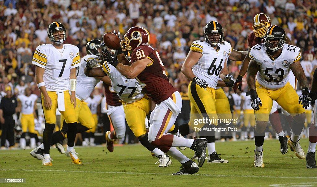 06c13405165 Washington Redskins linebacker Ryan Kerrigan intercepts a pass by ...