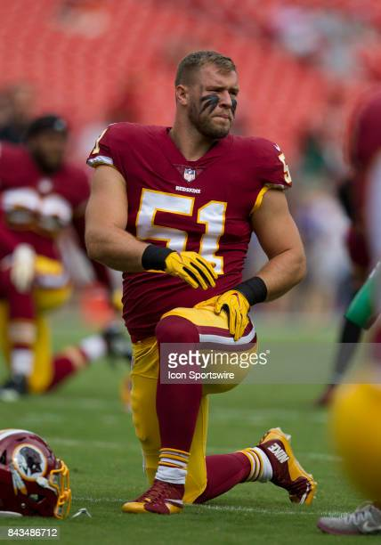 Washington Redskins linebacker Will Compton looks on during pregame stretching drills prior to the NFL preseason game between the Cincinnati Bengals...