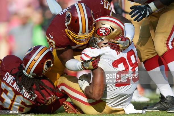 Washington Redskins linebacker Zach Brown tackles San Francisco 49ers running back Carlos Hyde during a NFL football game between the San Francisco...