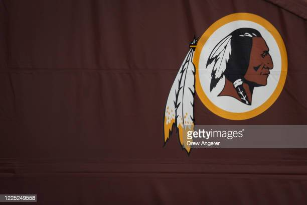 Washington Redskins logo is seen on the outside of FedEx Field on July 7, 2020 in Landover, Maryland. After receiving recent pressure from sponsors...