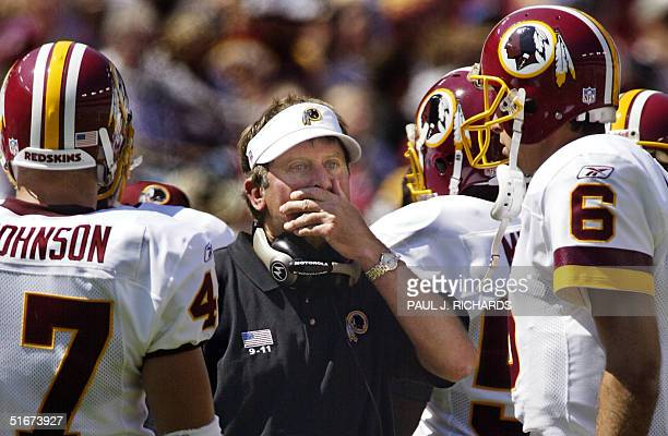 Washington Redskins new Head Coach Steve Spurrier meets with his players during a time out during first half NFL action in the home opening game...