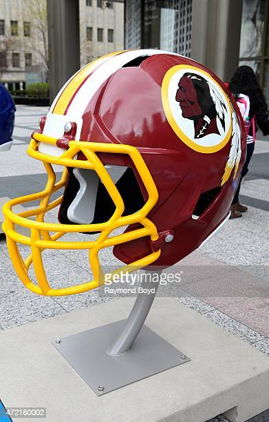 Washington Redskins NFL football helmet is on display in Pioneer Court to commemorate the NFL Draft 2015 in Chicago on April 30 2015 in Chicago...