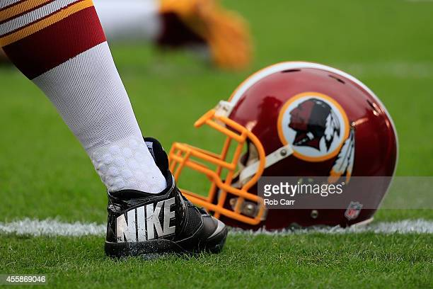 Washington Redskins Nike cleat and helmet is seen on the field before the game against the Philadelphia Eagles at Lincoln Financial Field on...