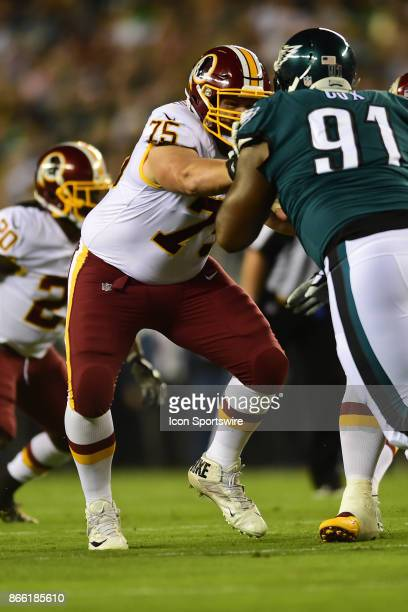 Washington Redskins offensive guard Brandon Scherff blocks Philadelphia Eagles defensive tackle Fletcher Cox during a NFL football game between the...