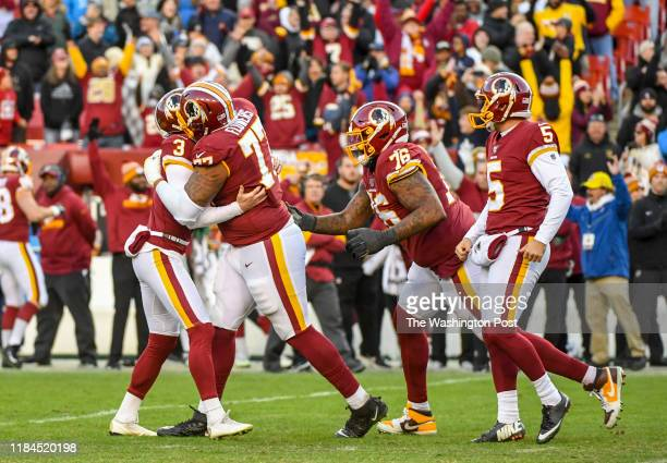 Washington Redskins offensive guard Ereck Flowers starts the celebration with kicker Dustin Hopkins after he nailed the game winning field goal for a...