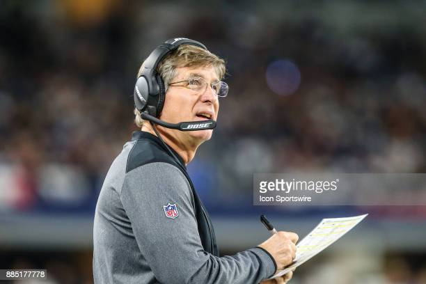 Washington Redskins offensive line coach Bill Callahan looks up at the video board during the game between the Dallas Cowboys and the Washington...
