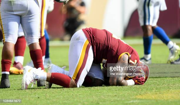 Washington Redskins offensive tackle Trent Williams is slow to get up during fourth quarter action against the Indianapolis Colts at FedEx Field